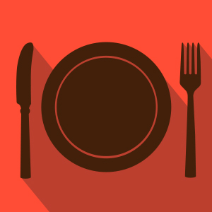 Brown plate knife and fork over red background