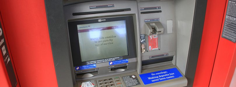 Man Gets Stuck Behind ATM and starts writing notes for help